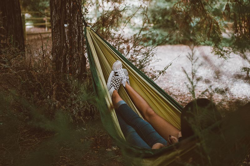 two people relaxing in hammock